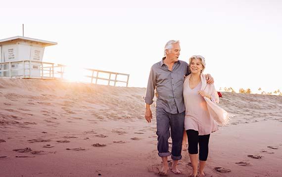 Pensioners Walking on Beach