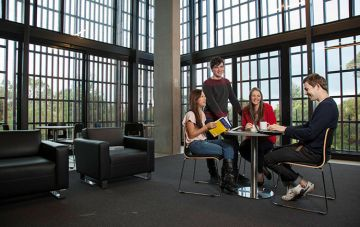 Student socialising in halls residence common area
