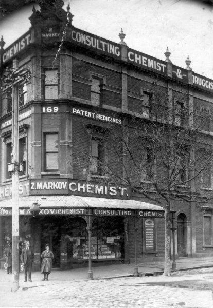Zal Markov's chemist shop at corner of Elgin and Drummond Streets, 1920s