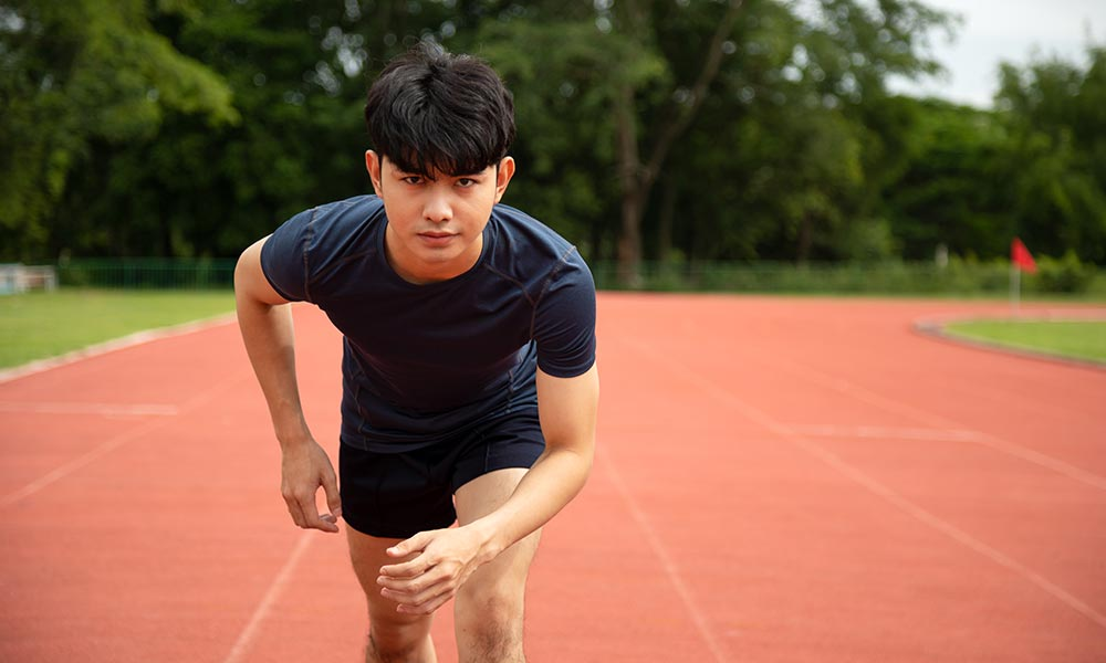 A student sprinting on a race track.