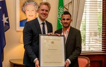 Ahmed Almohaimeed, pictured with Deputy Lord Mayor of the City of Melbourne, Arron Wood