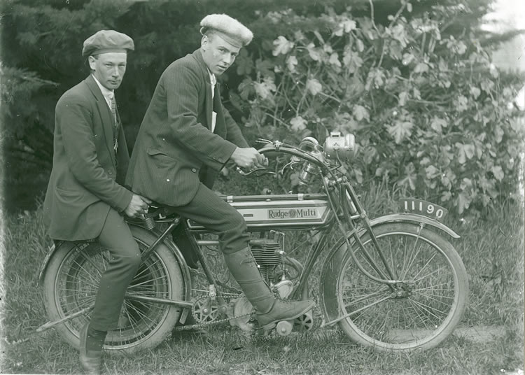 Martin and Charles Walker on a motorcycle
