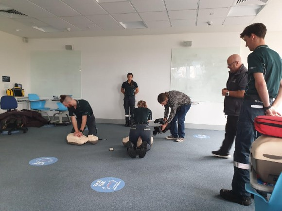 Image: Brian Haskins showing students how to carry out CPR
