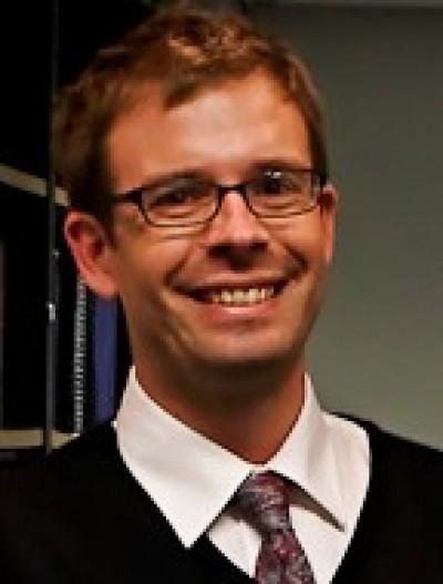 Dr Howard Manns