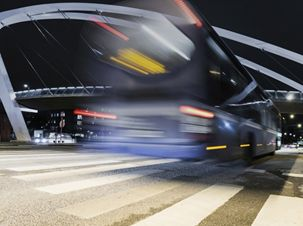Long exposure photo of a bus driving away