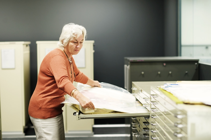 Large paper maps are filed in drawers