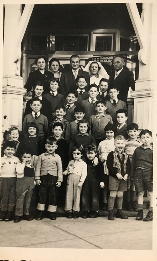 Orphaned and abandoned children at the Frances Barkman House. Leo Fink top right hand corner.
