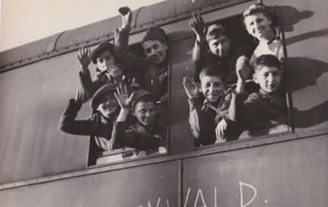Young survivors leaving Buchenwald on way to orphanages in France. KL Buchenwald was written on side of train.