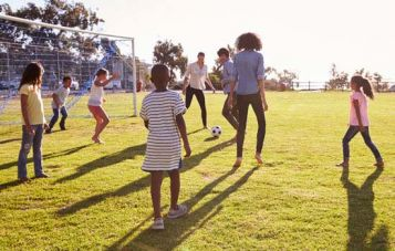 children play on a sports oval