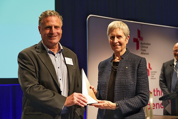 Professor Andrew Forbes accepting his Award from NHMRC CEO Professor Anne Kelso AO