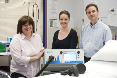 The treating team; Anne Maree Clinton, Dr Kate Hoy and Professor Paul Fitzgerald with the MST machine