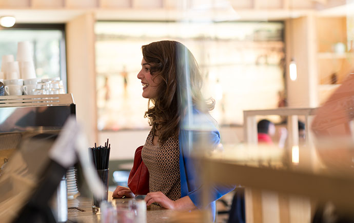 Female student at coffee counter