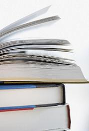 Image of a stack of books, with the top book open