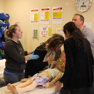 students and practitioners take part in a simulation exercise