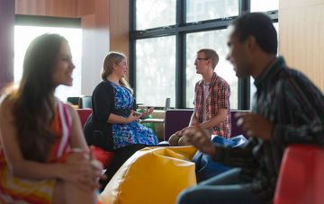 Students discuss options in background