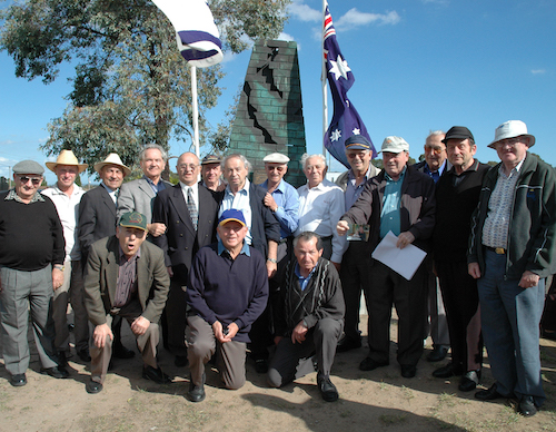 Buchenwald Boys Monument, built by Andrew Rogers, at Springvale Jewish Cemetery. Australian and Israeli flags are in the background.