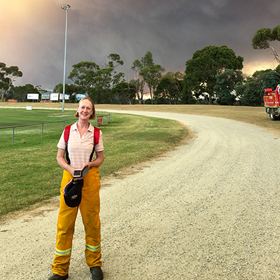 Anne Crawford in front of smoke from Bunyip fires.