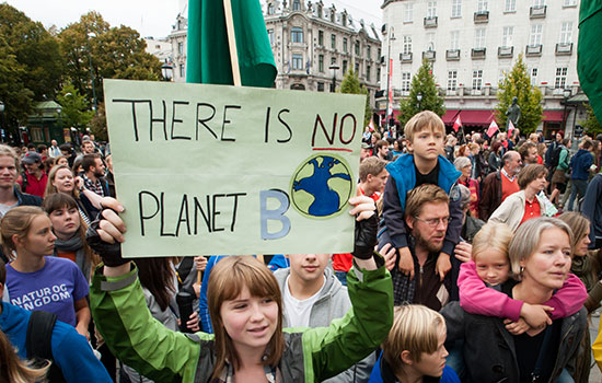 Thousands of parents and children marching to support action on climate change. Sign reads, 'There is No Planet B'. Oslo, Norway, September 21 2014.