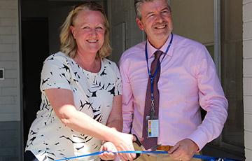 Robyn Langham and Ernan Hession cut a ribbon