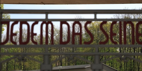 Sign on top of gates of Buchenwald concentration camp, now the Buchenwald Memorial. Translation: to each what they are due