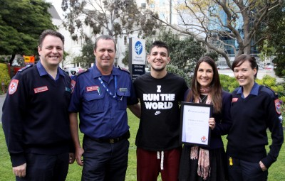 Cristina with Andrew, and the paramedics who assisted on the day