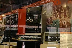 A view into the main display case showing an iconic 1970s photo journalist image and two famous 1970s minicomputers, a DEC PDP 9 and an HP 2100