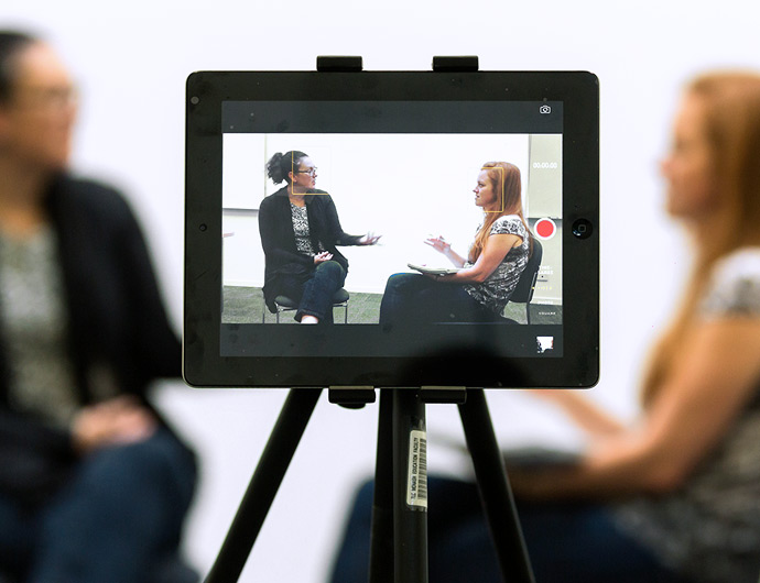 a conversation between two women being recorded on an ipad
