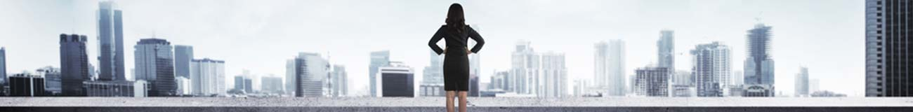 Woman in front of cityscape micro banner