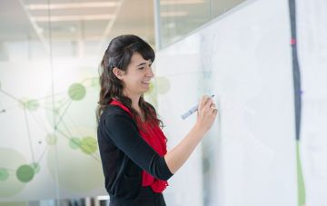 Staff writes on whiteboard