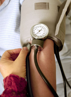 Photograph of a patient's arm having their blood pressure taken