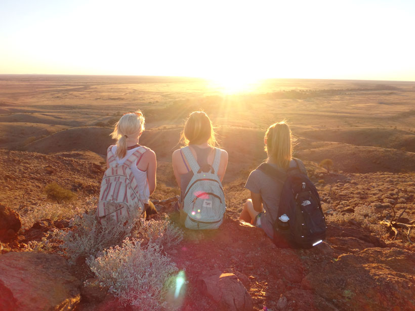 Girls watching sunset in the Australian outback, Broken Hill.