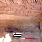 The adult burial in Room 1 found beneath an infant and covered by a shroud.