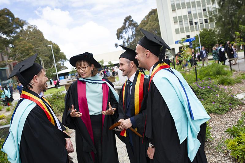 Deputy Dean of Medicine Professor Michelle Leech with three medical graduates