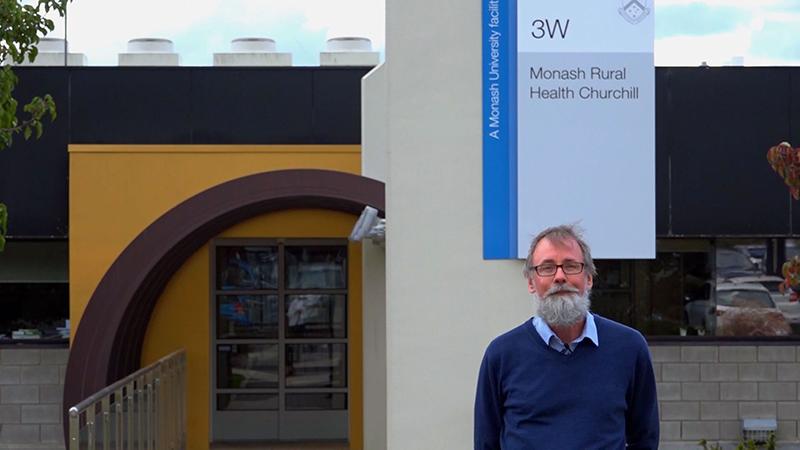 Associate Professor Shane Bullock in front of Monash Rural Health Churchill