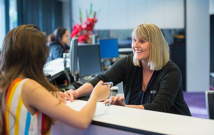 Staff helps student
