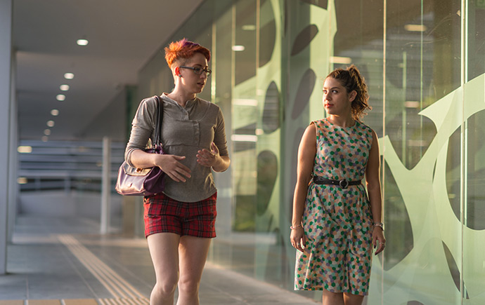 two females walking down a corridor