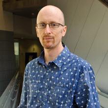 Professor Brett Hutchins