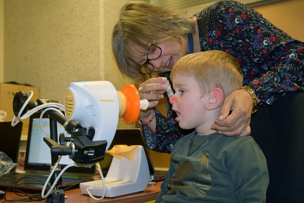 Latrobe Early Life Follow-Up project officer Melanie Reeves helps Branigan Kitwood with a simple breathing check.