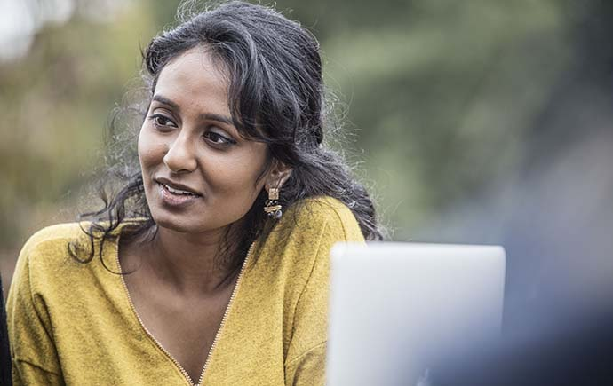 Close up of female student  by laptop