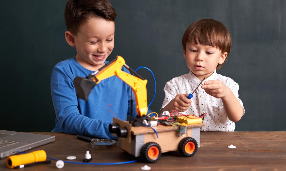 Two children build robots together