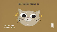 Cartoon cat face with the message: Hope you're feline okay
