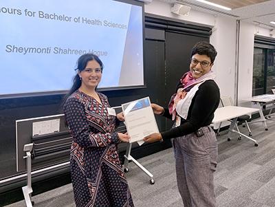 2020 Honours for the Bachelor of Health Sciences Award winner Sheymonti Shahreen Hoque with Dr Darshini Ayton