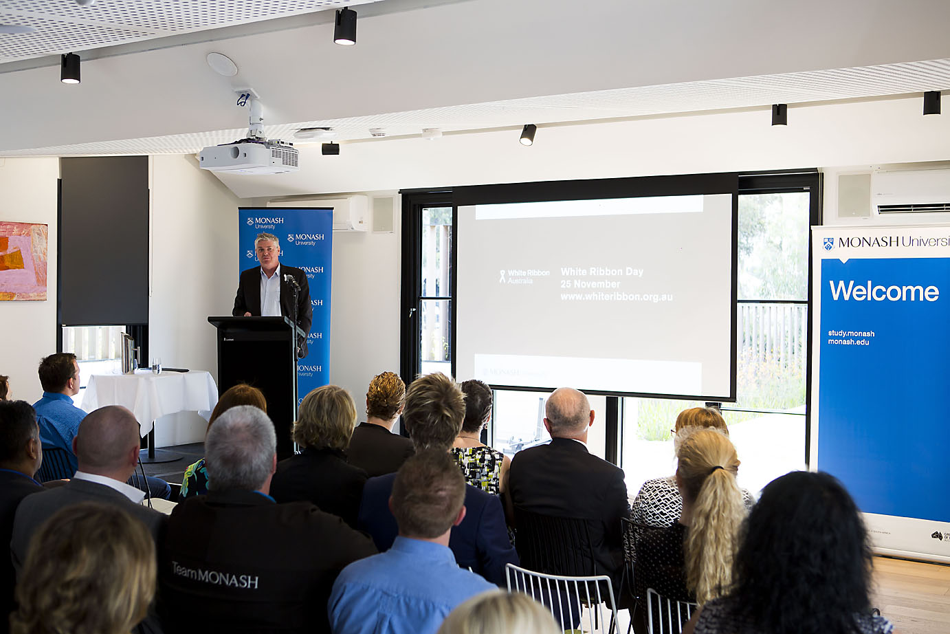 Mr Andrew Picouleau speaking about initiatives being taken at Monash to support the White Ribbon Movement
