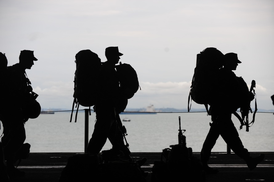 silhouetted soldiers walking along