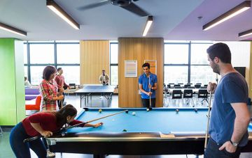 Students playing pool doubles