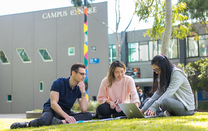 Students studying outside campus centre