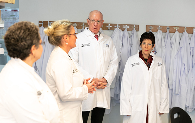 Their Excellencies, the Governor-General David Hurley and Mrs Hurley, taking a tour of a Monash BDI laboratory with Associate Professor Mireille Lahoud (L) and Professor Nicole La Gruta (R)