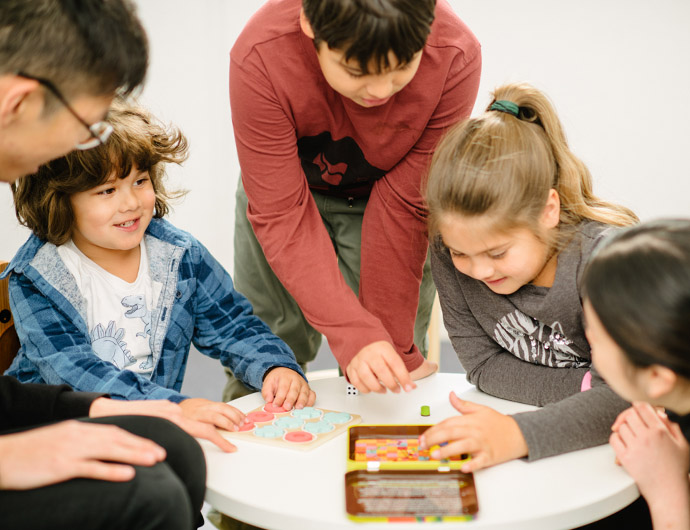 children playing a game with two adults