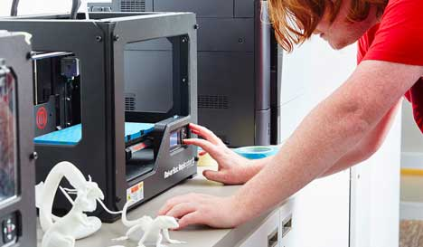 A research student working with a 3D model prototype
