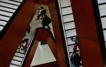 Students walking on Green Chemical staircase aerial view